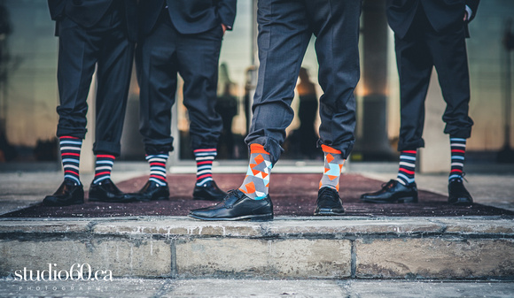 Bride & Groom pose for Photographers at MIssissauga Convention Centre. Groomsmen wear funky socks to match the wedding party. Bridal party poses outside the Mississauga Convention Centre in Brampton Ontario. Brampton Wedding Photography by Studio60 Photography